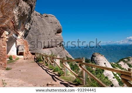 Narrow path and panorama in Montserrat mountain, Spain
