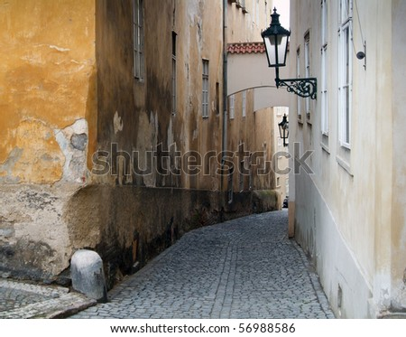 Narrow pedestrian alley between tenement houses in Prague. Stare Mesto. Old town.