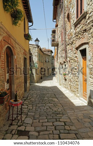 narrow stony street in tuscan borgo Montefioralle,  sometimes claimed to be the birthplace of Amerigo Vespucci,  Greve in Chianti, Italy, Europe - stock photo
