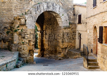 Narrow Street and Ancient Etruscan Gate of Volterra in Italy
