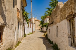 Narrow street in an old village on Zakynthos (one of the Ionian Islands of Greece)