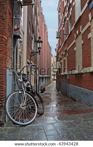 Narrow street in the Amsterdam center on a rainy day