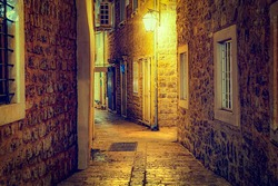 Narrow street in the evening in the old town of Budva. Montenegro