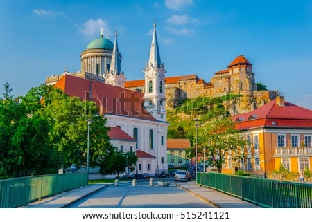Narrow street in the hungarian city Esztergom with the church of saint Ignac and basilica on top of the hill.