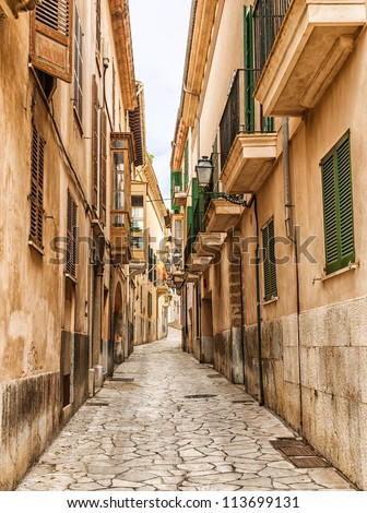 Narrow street in the old town of Palma de Mallorca, Spain