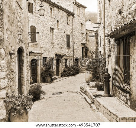 Narrow street in the old village Tourrettes-sur-Loup in France. The Old style sepia.
