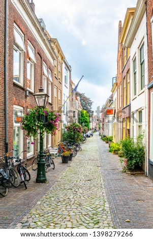 Narrow street leading to the Pieterskerk in Leiden, Netherlands #1398279266