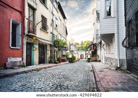 narrow street lined with stone...