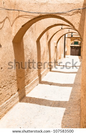 Narrow  street of old part Yazd city . Alley made with hand made mud-brick. Yazd, Israel