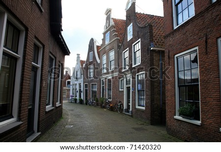 Narrow street - path in small town Blokzijl in Netherlands,