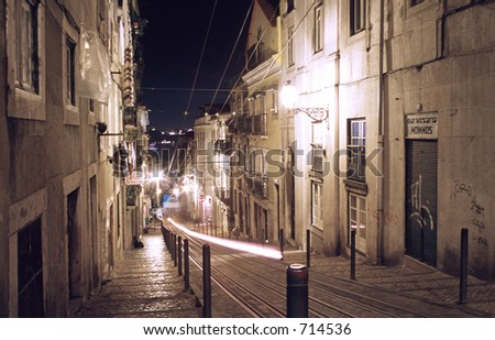 Narrow street with funicular railway in Lisbon, Portugal