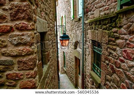 narrow street with stone houses ...