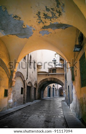 Narrow street with vault in Florence, Italy