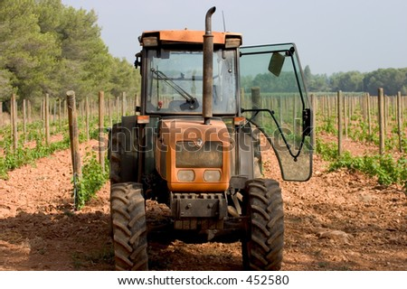 Narrow tractor in a vineyard in France
