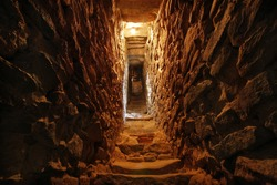 narrow tunnel in the wall of a fortress