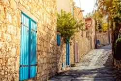 Narrow uphill cobbled street at Lofou village. Limassol District, Cyprus.