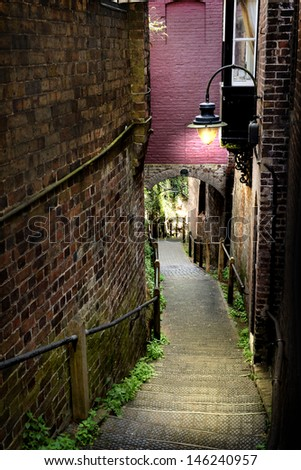 narrow walkway steps leading downhill with an Old-fashioned light, dust lighting high contrast and saturation