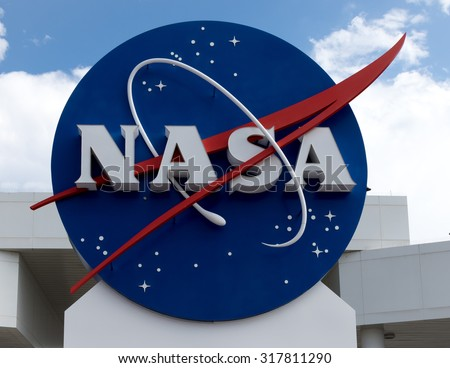 Photo of  NASA sign at Cape Canaveral, Kennedy Space Center with blue cloudy sky background. Elements of this image furnished by NASA.