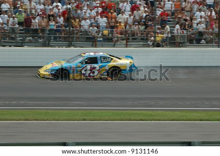 NASCAR  no. 43 with  smoke and  flames.