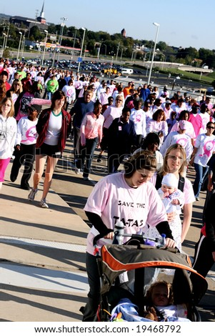 Nashville, TN - October 25: Thousands of people walk to support breast cancer research in Nashville, TN on October 25.  40,954 women and 362 men died from breast cancer in the United States in 2004.