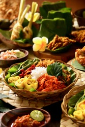 Nasi Campur Bali. A popular Balinese meal of rice with variety of side dishes which are served together with the rice and more as optional extras.