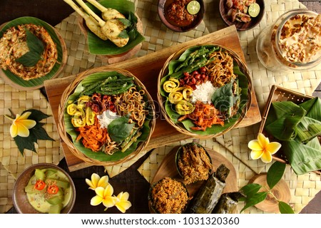 Nasi Campur Bali. Popular Balinese meal of rice with variety side dishes, which are served together with the rice and more as optional extras.