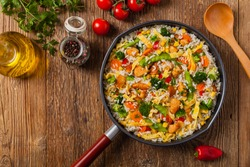 Nasi goreng. Fried rice with egg and vegetables. Top view.