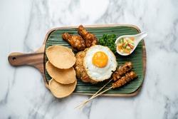 Nasi goreng with prawn crackers and chicken satay , indonesian dish,Chicken Satay Fried Rice