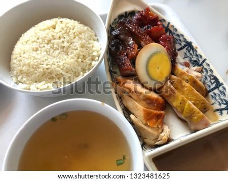 Nasi hainan ayam (hainan chicken rice) complete set with white background. Top view close up detail