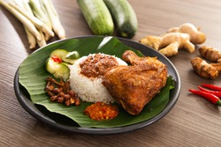 Nasi Kukus is usually comprising freshly steamed rice, crispy fried chicken, sambal belacan, acar and a curry gravy