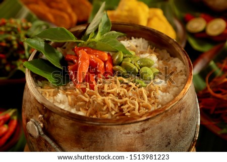 Nasi Liwet Sunda. A traditional Sundanese rice dish of white rice cooked with spices and topped with anchovies, chili peppers and broad beans