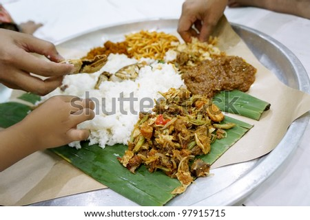 Nasik Ambeng, famous dish from Java served in big plate and shared by 3 people (shallow depth of field)