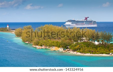 NASSAU, BAHAMAS - JAN. 13:  Carnival cruise ship enters the port of Nassau, Bahamas on Jan. 13, 2013.  The island of the Bahamas is most notably one of the most popular Caribbean cruise locations.