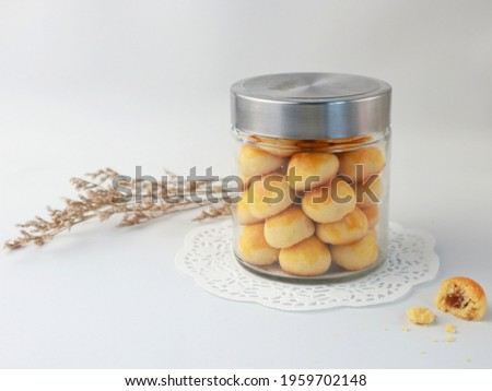 Nastar Cookies, Pineapple tarts or nanas tart are small, bite-size pastries filled or topped with pineapple jam, commonly found when Hari Raya or Eid Al Fitr or Lebaran. Selective focus.