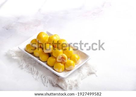 Nastar is pineapple tart cookies isolated on marble white background. Indonesian popular cookies during Eid Mubarak.