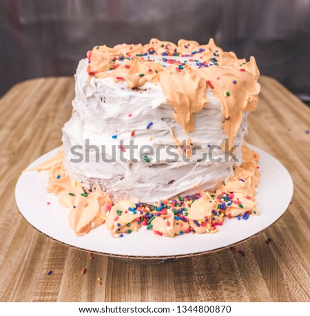 Nasty cake on a wooden table.
