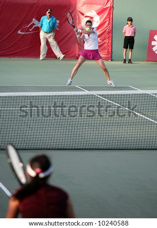 """Nathalie Dechy of France playing Shuai Peng at the Qatar Open, February, """"008"""