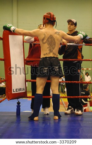 National Championship of Kickboxing and Muaythai (Portugal) - Fighter putting the helmet