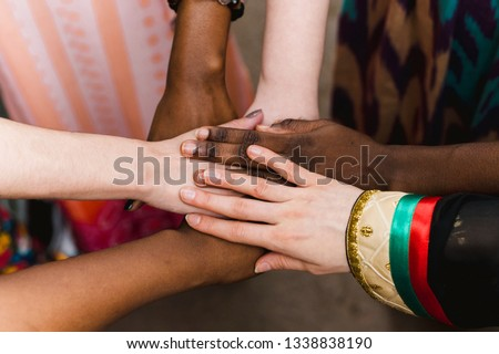 National diversity. People of different appearance and nationality stand in a circle together and hold hands. Team building and partnership business concept #1338838190