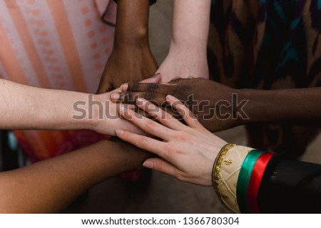 National diversity. People of different appearance and nationality stand in a circle together and hold hands. Team building and partnership business concept #1366780304