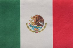 National emblem of Mexico close up. Tricolor green, white, red and coat of arms.