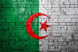 National flag of Algeria on brick  wall background.The concept of national pride and symbol of the country. Flag  banner on  stone texture background.