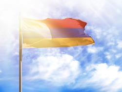 National flag of Armenia on a flagpole in front of blue sky