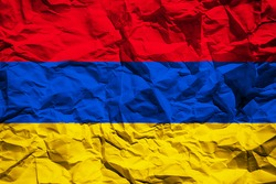 National flag of Armenia on crumpled paper. Flag printed on a sheet. Flag image for design on flyers, advertising.