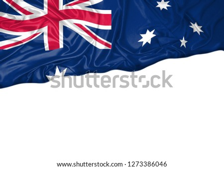 National flag of Australia hoisted outdoors with white background. Australia Day Celebration. Copy space. Front view