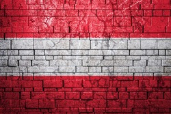 National flag of Austria on brick  wall background.The concept of national pride and symbol of the country. Flag  banner on  stone texture background.