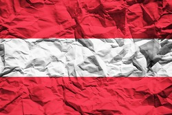 National flag of Austria on crumpled paper. Flag printed on a sheet. Flag image for design on flyers, advertising.