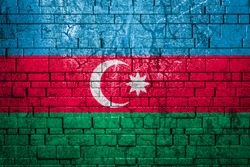 National flag of Azerbaijan on brick  wall background.The concept of national pride and symbol of the country. Flag  banner on  stone texture background.