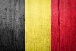 National flag of Belgium  depicting in paint colors on old clothl. Flag  banner on  fabric texture background.