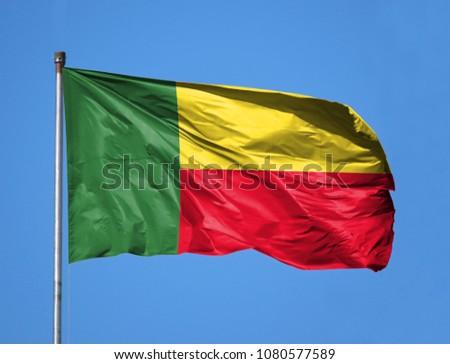 National flag of Benin on a flagpole #1080577589